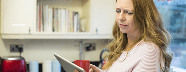 Woman looking at tablet screen